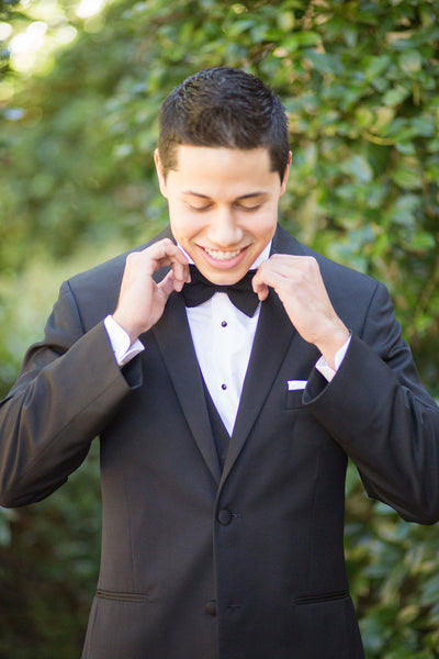 Groom wearing a tux and bowtie
