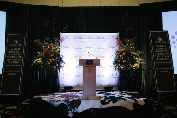 Stage Designed with Flowers, Step and Repeat and Banners