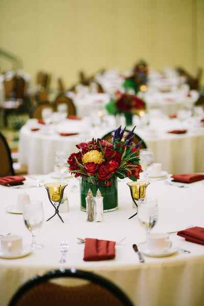 Red, Purple and Greem Centerpieces Set on Dinner Tables, Corporate Event