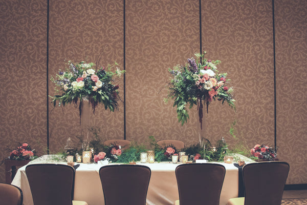 Wedding reception tall centerpiece, head table, with peach flowers, roses, greenery