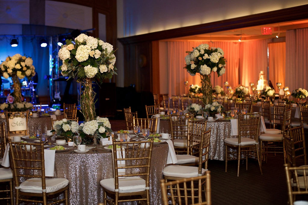 gold chivari chairs, tall white floral arrangements, sequin linens