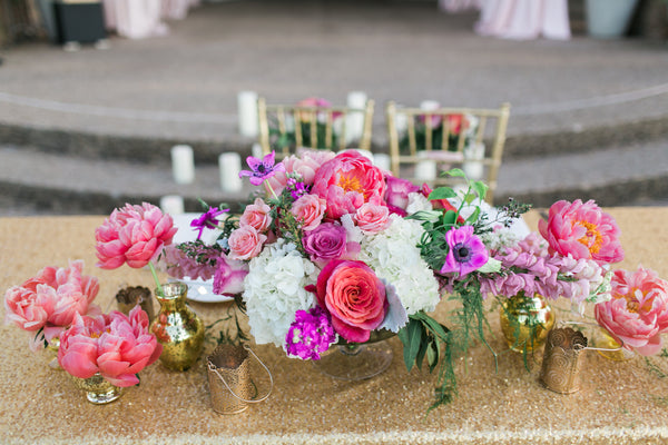 Gold sequin linen and coral wedding flowers