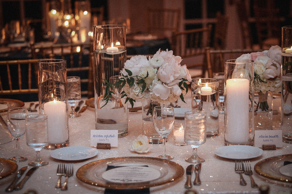 All white wedding with white sequin linens and gold chargers