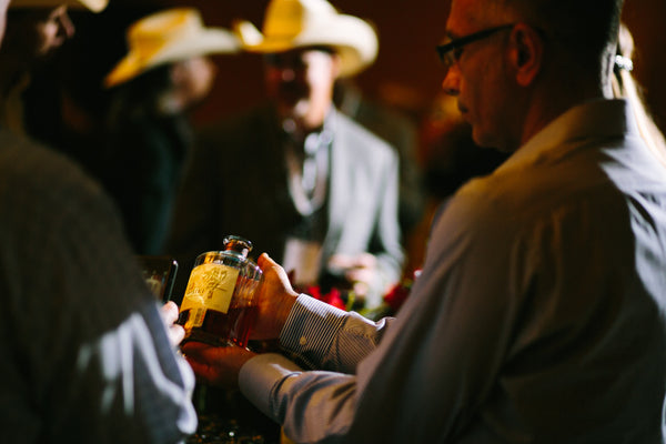 Man Servicng Bourbon at Corporate Event Dallas Tx