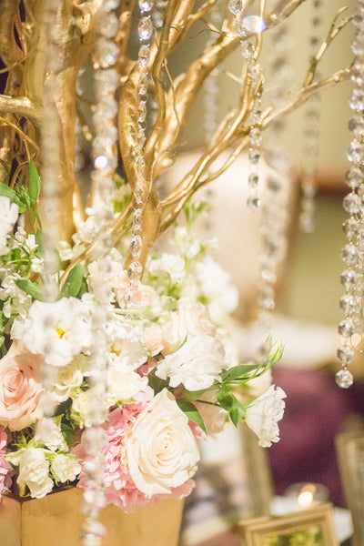 Pink and cream wedding centerpieces with crystal drops