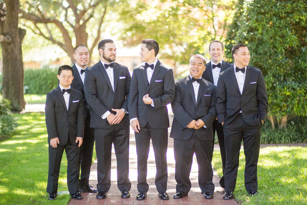 Groom and groomsmen on wedding day, wearing tux's