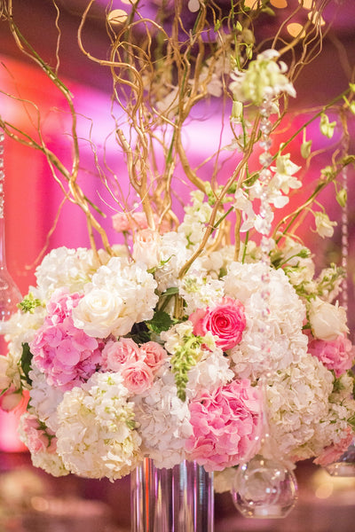 Pink and white wedding centerpieces with crystals