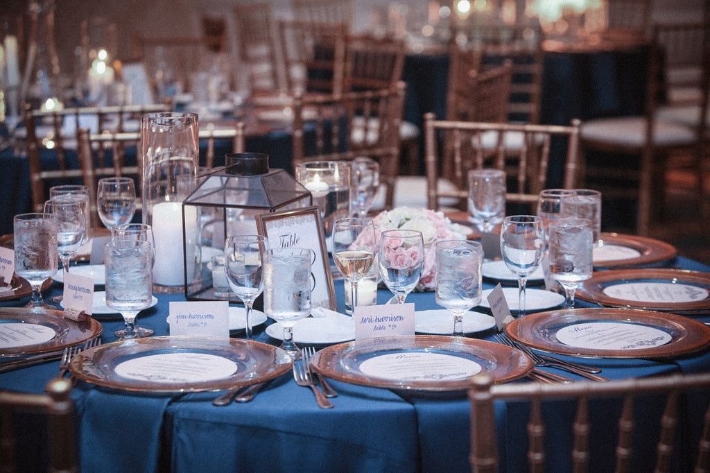 Navy blue weddings with gold dipped china and chargers