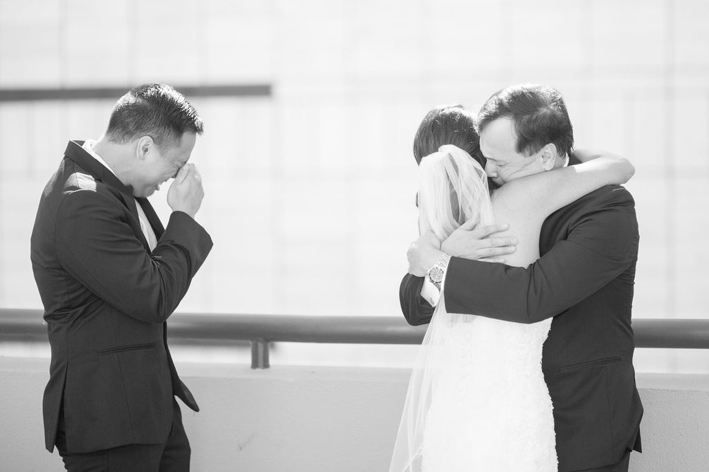 Emotional bride and dad photo on wedding day