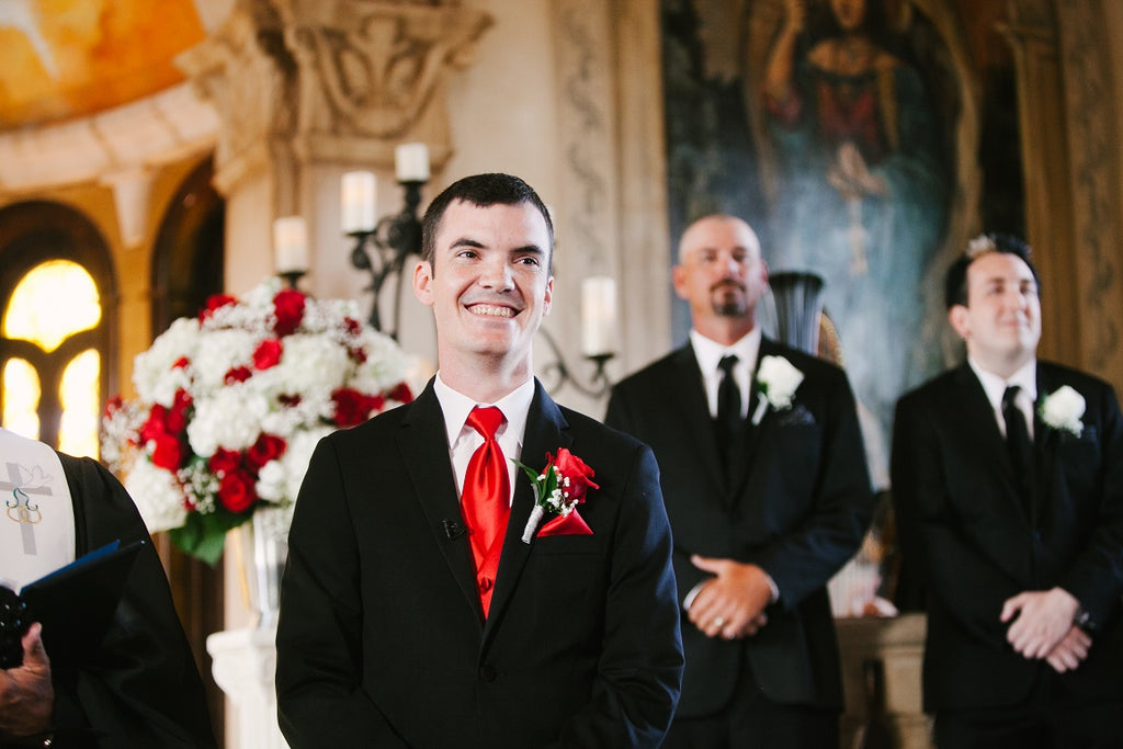 Grooms attire, black tux, red tie, red roses