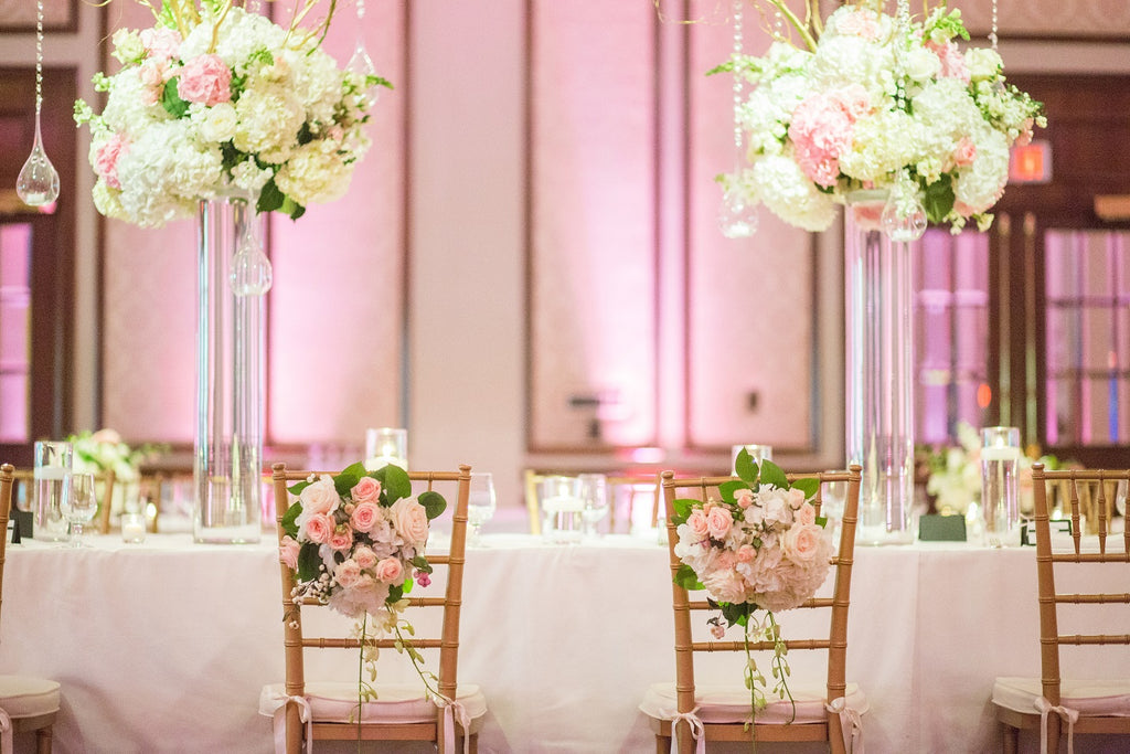 Pink wedding reception with tall centerpieces