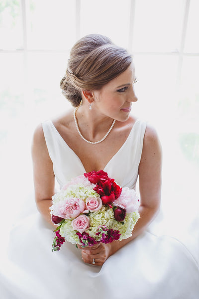 Bridal Up-Do, White Wedding Gown, Pearls, Pink Bouquet