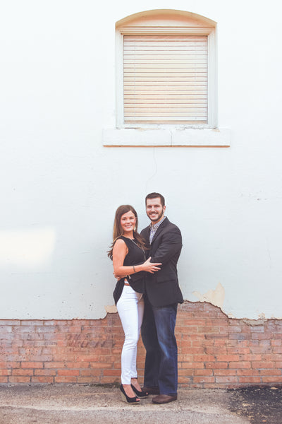 Outdoor engagement pictures with vintage building