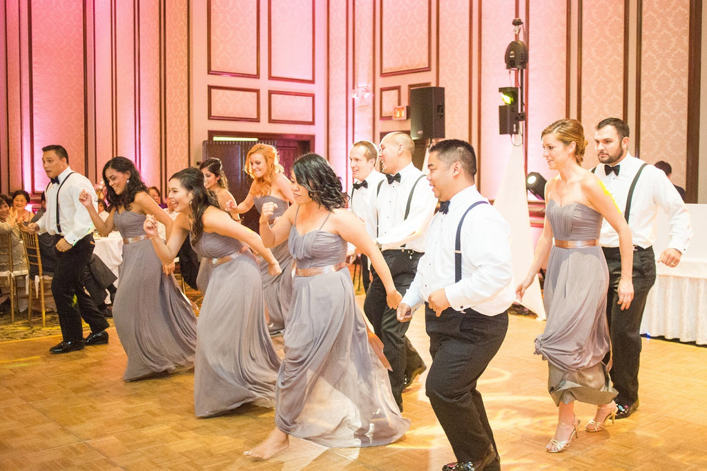 Dancing bridal party at the wedding reception