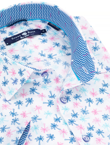 Close-up view of a Stone Rose short-sleeve button-up with a palm tree print and contrasting chevron print on the inside collar.