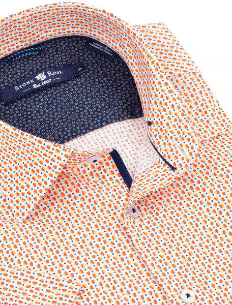 Close-up view of a short-sleeve, button-up shirt from Stone Rose that has an orange grapefruit pattern with small navy blue polka dots.