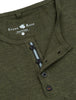Close-up view of the reflective ribbon detailing along the buttons of the Stone Rose short-sleeve henley in khaki.