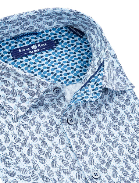 Close-up image of a Stone Rose short-sleeve button-up with a blue pineapple print.