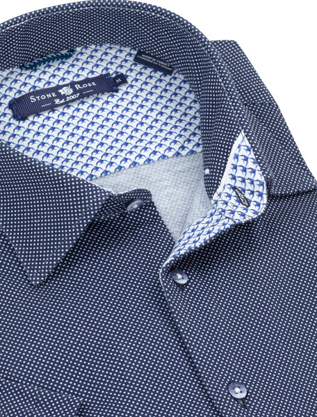 Close-up view of a Stone Rose blue button-up shirt with a contrasting geometric bird print on the inside of the collar.