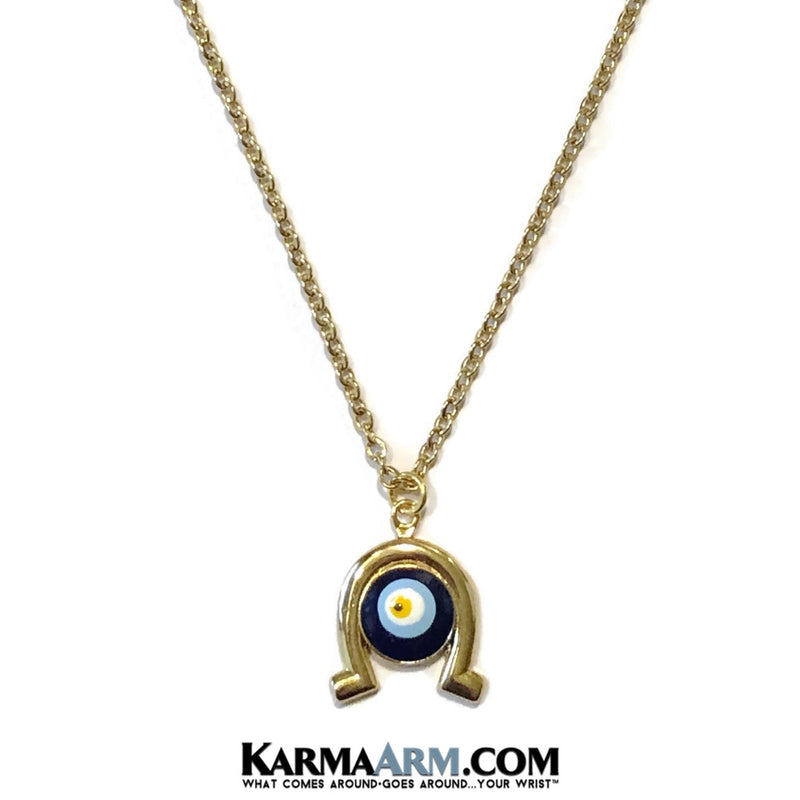 Horseshoe Evil Eye Necklace. Lucky Charm JuJu jewelry.