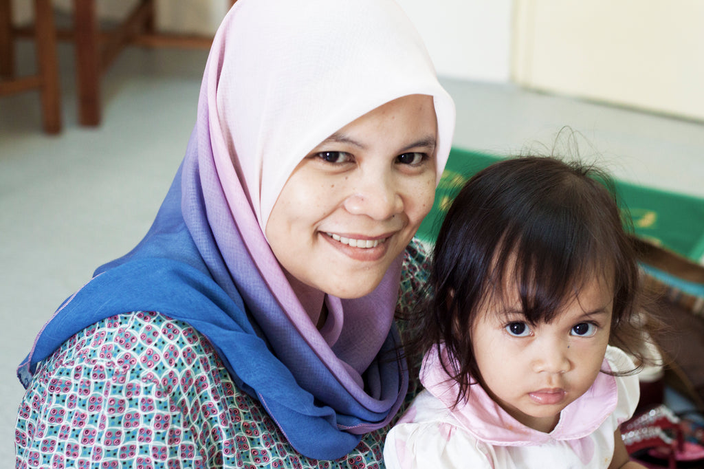 Batik Boutique artisan Noor with her daughter