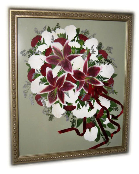 This large 20x24 frame displays a nearly full wedding bouquet. Choose a cascading/free form design or a classic bouquet with wrapped stems. There is plenty of space to accent this custom work of art with a photograph, invitation and/or your groom's boutonniere. Complete you preserved bouquet with a hand selected frame and mat to match your personal style. Prices start at $ 880.