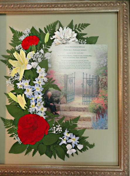 This Victorian pressed flower design is the ideal size to display a flower arrangement along with both a photograph and a prayer card. Customize this display with your selection of frame and mat. Prices start at $495.