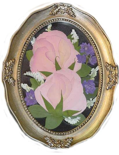 This small 5x7 Victorian style design is reminiscent of an oil painting. With room for a few small flowers from your bouquet, mother's corsage or a singular boutonniere you will be able to showcase your flowers as a work of art. With an option to add a small photograph. you can complete your design with a custom frame and mat to match your personal style. Prices start at $95.