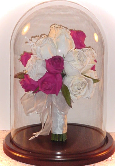This 8x12 table top dome will have you feeling nostalgic as you view a your flower arrangement from every angle. The table top domes offer the option to display a miniature bouquet of flowers with ribbon wrapped stems. Customize this freeze dried floral arrangement with either a oak or silver base. You can add an additional small memento and/or custom nameplate to complete your design. Prices start at $500.