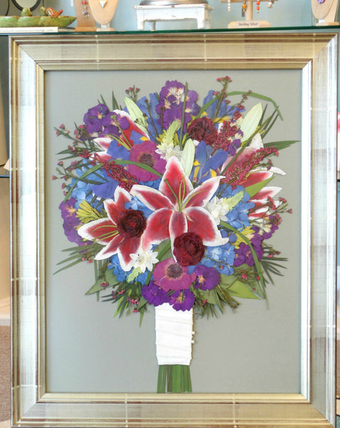 This 16x20 Victorian inspired pressed design showcases your preserved wedding bouquet as a work of art. You have an option to include your groom's boutonniere and a small invitation. Customize this display with your selection of frame and mat to match your personal style. Prices start at $595.