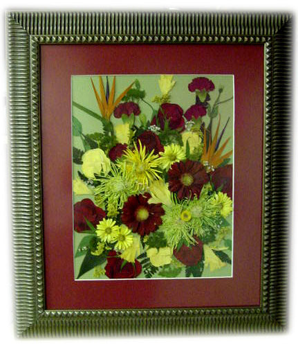 This large 20x24 Victorian style design showcases a large assortment of memorial flowers as a work of art. With such a large canvas, you have an option of adding a photograph, a small program, a prayer card and/or a custom nameplate. Complete the design by choosing from our large selection of frames and mats. Prices start at $880.