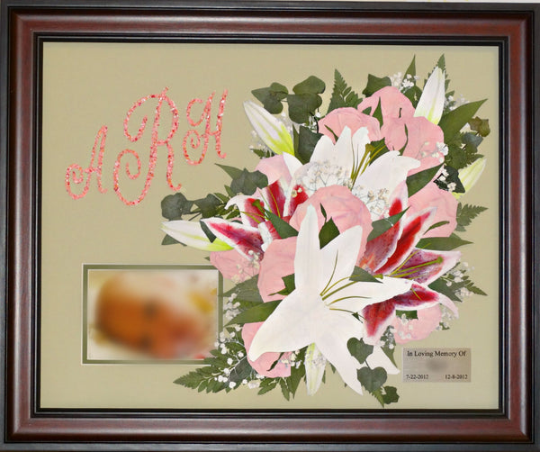 This free form design in a 16X20 frame allows you to showcase your memorial or special occasion flowers as a work of art. Customize this display with photograph, prayer card, nameplate and or a flower petal monogram. We have a large selection of frames and mats to match your personal style. Prices start at $595.