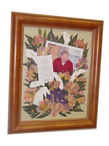 This Victorian pressed flower design is the ideal size to display a flower arrangement along with a photograph, a prayer card along with an option to add a personalized nameplate. Customize this display with your selection of frame and mat. Prices start at $495.