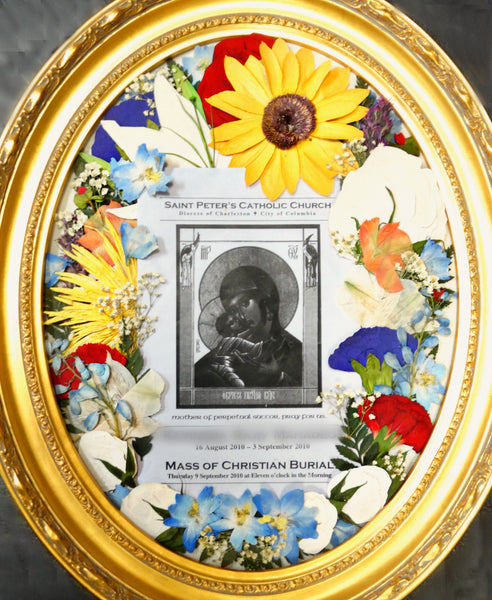 This pressed display showcases your beautiful memorial flowers with an option to add a prayer card, program and or photograph. This design is reminiscent of an oil painting. Customize this display with your selection of frame and mat. Prices start at $500
