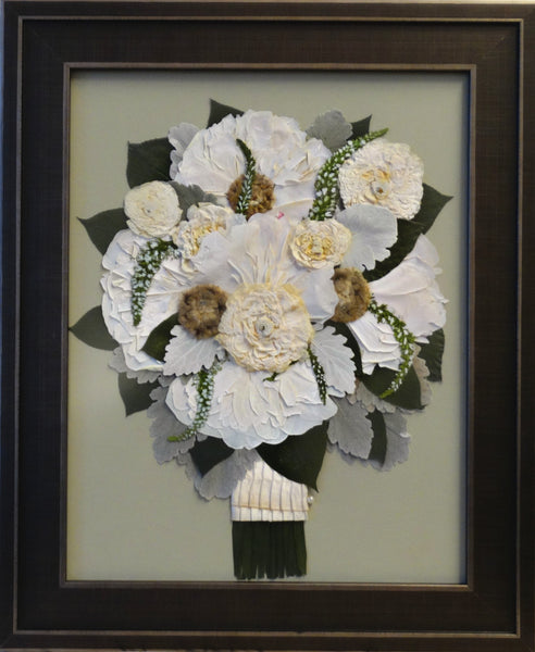 This 11x14 frame will fit a miniature version of your wedding bouquet with ribbon wrapped stems and an option of including your groom's boutonniere. Customize this display with your selection of frame and mat to match your personal style. Prices start at $445.