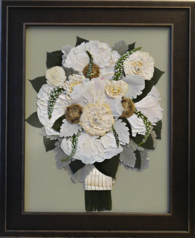 This 11x14 frame will fit a miniature version of your wedding bouquet with ribbon wrapped stems and an option of including your groom's boutonniere. Customize this display with your selection of frame and mat to match your personal style.