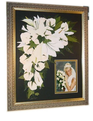 This is a piece right from our showroom floor. This cascading pressed wedding bouquet paired with a bride's photograph fills the 16x20 frame. This Victorian inspired style allows you to showcase your preserved wedding bouquet as a work of art. With an option to include your groom's boutonniere and/or a small invitation. Customize this display with your selection of frame and mat to match your personal style.