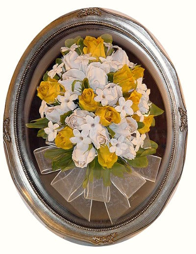 This Victorian Style Design, comes to life in this 11x14 dome arrangement. This three dimensional flower recreation will showcase your wedding or memorial flowers like a work of art. With the option to add a small photograph and or boutonniere to add to your display. Customize this with a frame and mat to match your personal style. Prices start at $455.