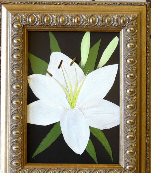 In this small 5x7 frame, a singular flower with greenery is showcased as a work of art. This Victorian inspired design is reminiscent of an oil painting and will display a singular flower, as shown or an assortment of memorial flowers. You have an option to include a custom nameplate, a small prayer card and/or photograph. Finish your custom design by choosing from a large selection of frames and mats. Prices start at $95.
