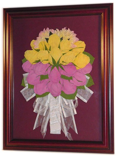 In this 12x16 frame we can design a smaller version of your wedding bouquet. This Victorian inspired style allows you to showcase your pressed flowers resembling your wedding bouquet as a work of art. You have an option to include your groom's boutonniere and a small invitation. Customize this display with your selection of frame and mat to match your personal style. Prices start at $495.