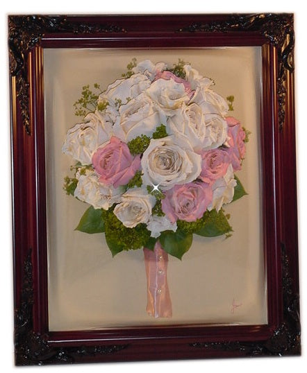 This custom, three dimensional design will preserve your special flowers in this 12x16 dome. This Victorian style display will be a timeless treasure to keep for years to come. You have an option to add a small photograph, prayer card, invitation and/or boutonniere to your priceless design. Customize this with a frame and mat to match your personal taste. Prices start at $560.