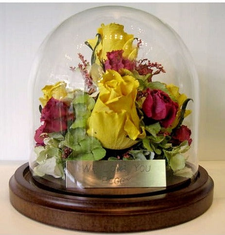 This petite 6x6 dome will showcase a small assortment of your selected flowers. Customize this freeze dried floral arrangement with an oak or silver base. You can add a small memento, token and/or custom nameplate to complete your design. Prices start at $195.