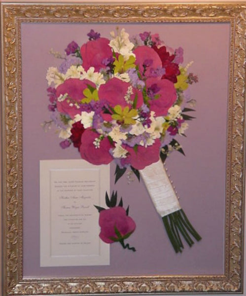 This 16x20, Victorian inspired pressed design allows you to showcase your preserved wedding bouquet as a work of art. An invitation is a great addition to this pressed design., you also have an option to include your groom's boutonniere. Customize this display with your selection of frame and mat to match your personal style. Prices start at $595.