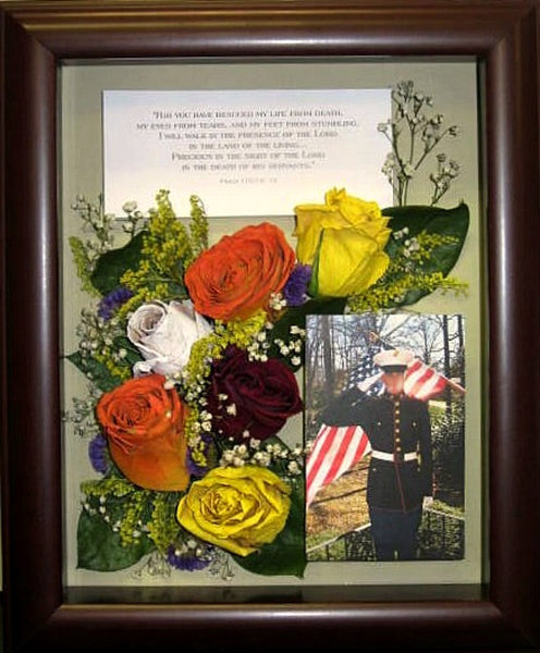 A smaller 8x10 bubble dome or beautiful shadow box (shown here), will showcase and enhance your floral arrangement. Whether you choose to fill the frame with several select flowers or just few, this three dimensional design will be a keepsake to treasure for years to come. Customize this display with a small memento such as a photograph, prayer card or custom nameplate. Finalize your design with your selection of frame and mat. Prices start $320.