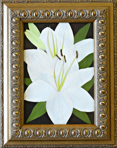 In this small 5x7 frame, two flowers with added greenery is showcased as a work of art. This Victorian inspired design is reminiscent of an oil painting and will display an array of flowers. You have an option to include a custom nameplate, a small prayer card and/or photograph. Finish your custom design by choosing from a large selection of frames and mats. Prices start at $95.