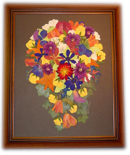 This 16x20 Victorian inspired pressed design allows you to showcase your preserved wedding bouquet as a work of art. There is an option to include your groom's boutonniere, a small photograph and/or a small invitation to add to your preserved design. Customize this display with your selection of frame and mat to match your personal style. Prices start at $495.