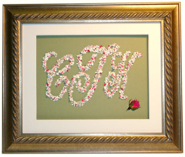 This custom, flower petal monogram design fills the 8x10 frame. Using flower petals from your wedding bouquet, you can choose from a three letter design or a singular letter design. Customize this display by selecting from a large selection of frames and mats to match your personal style. Prices start at $195.