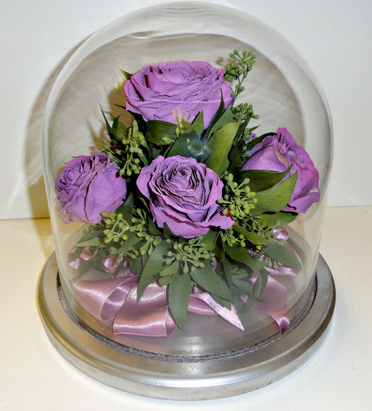 This 8x8 table top dome will have you feeling nostalgic as you view your flower arrangement from every angle. You have an option to display a miniature bouquet or a full display of your special flowers. Customize this freeze dried floral arrangement with an oak or silver base.You can add a small memento and/or custom nameplate to complete your design. Prices start at $430.