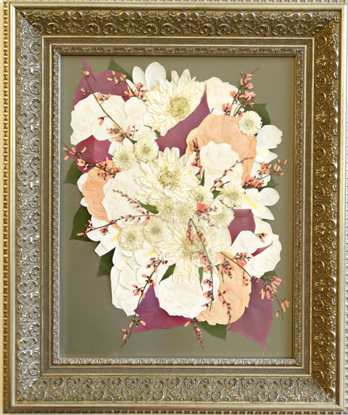 In this Victorian style pressed design, reminiscent of an oil painting, a cascading bouquet fills the 16x20 frame allowing you to showcase your preserved wedding bouquet as a work of art. With an option to include your groom's boutonniere, a photograph and/or a small invitation. Customize this display with your selection of frame and mat to match your personal style. Prices start at $595.