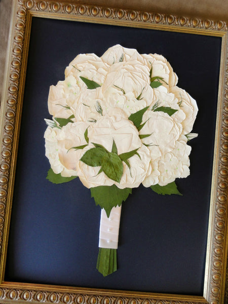 This 16x20 Victorian inspired pressed design allows you to showcase your preserved wedding bouquet as a work of art. There is an option to include your groom's boutonniere, a small photograph and/or a small invitation to add to your preserved design. Customize this display with your selection of frame and mat to match your personal style. Prices start at $595.